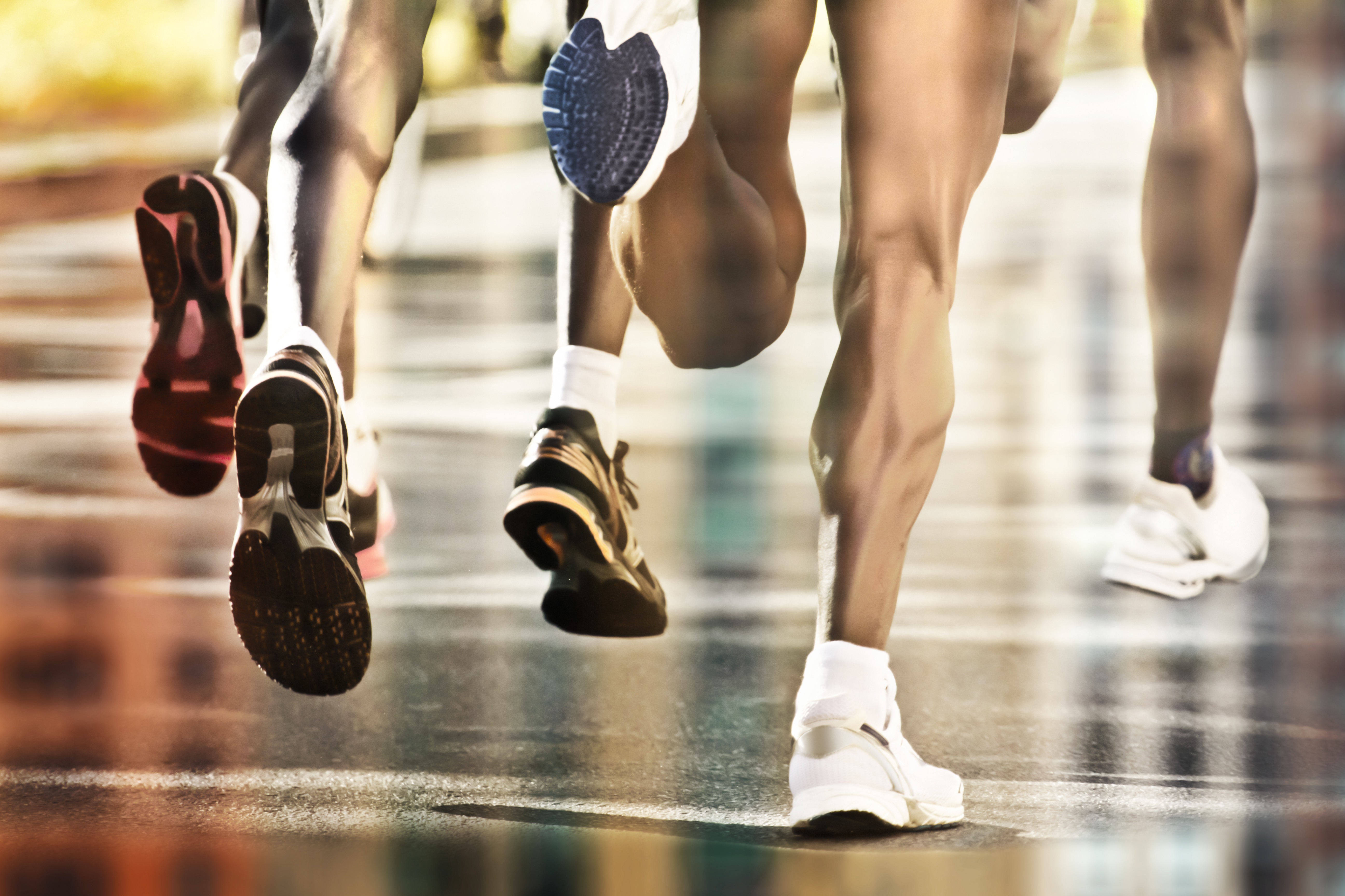 Close up on runners feet during race.