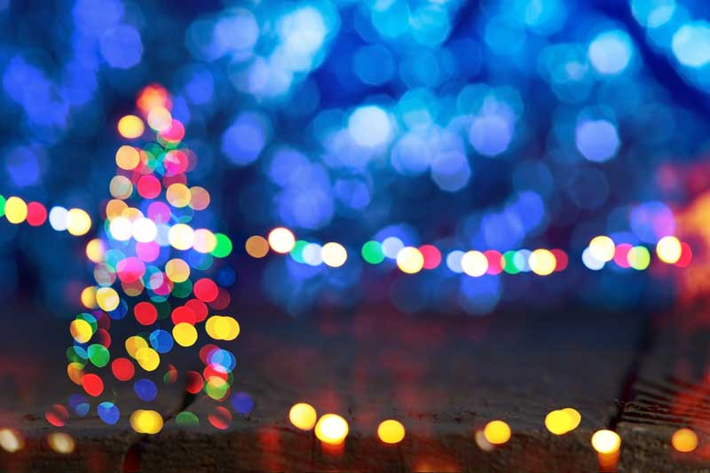 Colorful Christmas Lights and Tree out of focus.